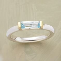 BLUE TOPAZ BAGUETTE RING -- A blue topaz baguette ring, with gold prongs embracing a slender loaf of azure topaz. Sterling band with 18kt gold vermeil setting. Handmade. Whole sizes 5 to 9.