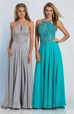 Gorgeous gown that features a small key hole with a halter style top, and a completely open back
