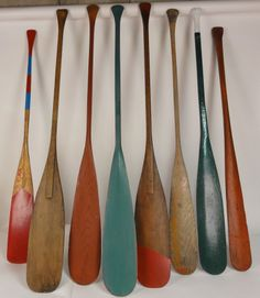 "Antique Canoe Paddles A group of 8 old vintage and antique wooden canoe paddles, Most with old paint. Measure 54"" to 59"" long."