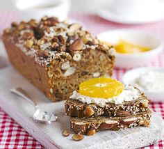Start the day well with this fruit and nut breakfast loaf, spread with cream cheese and topped with orange or apple. It keeps for a month, too