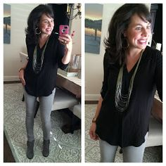 Gray jeans. Black pullover, taupe booties, long silver necklace