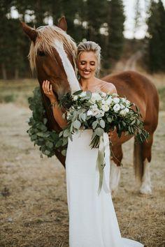 This horse can't resist the bride's gorgeous silver dollar eucalyptus and white ranunculus | image by The Jar Photography #elegantweddinginspo #weddingphotoinspiration #weddingphotoideas #weddingdress #bridalportrait #bridalstyle #bridalfashion #bridalinspo #bridalinspiration #bride #bridalhair #bridalhairstyle #bridalmakeup #gettingreadyinspo #bridalbouquet
