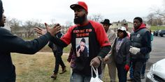 Michael Brown Sr. handed out Turkeys on Saturday in the Ferguson, Missouri community where his son, Michael Brown Jr., was fatally shot by a police officer in August.   The father took part in Ferguson's annual turkey giveaway two days before a gra...