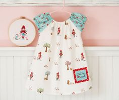 LOVE this little girl's dress.  The sleeves and the imagination in the print would leave any childhood memory soaring