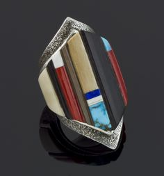 Ring | Edison Cummings.  Sterling silver inlayed with wood, fossil, ivory, turquoise and coral.