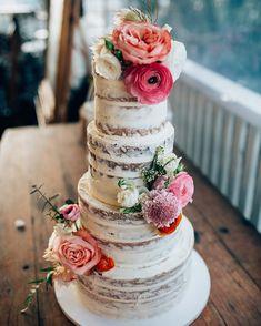 Gorgeous semi naked wedding cake adorned with flowers #nakedweddingcake