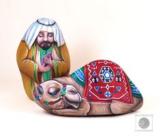 Wise man and his camel - painted rocks by Ernestina