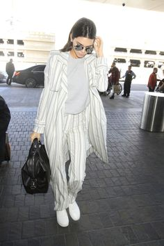 Kendall Jenner wearing Sally Lapointe Cashmere Knit Tank, Sally Lapointe Striped Silk Wool Duster Coat, Givenchy Small Nightingale Bag, Céline Sneaker Pull on in Optic White Stretched Lambskin