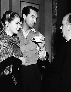 Cary Grant and Ingrid Bergman with Alfred Hitchcock on the set of Notorious (1946)