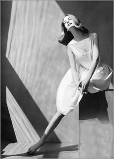 Nena von Schlebrugge in white cotton and dacron sun dress threaded with ribbon by L'Aiglon, photo by Leombruno-Bodi, Vogue, May 1, 1959