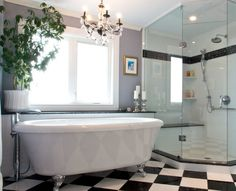 Chic black-and-white bathroom designed with our @BainUltra Balneo Cella freestanding bathtub. Discover it here : http://www.bainultra.com/therapeutic-baths/our-collections/balneo/cella-7240