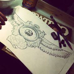 clock and wings tattoo for chest or back maybe