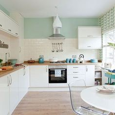 Traditional kitchen with pastel green walls Kitchen decorating Style at Home uk Kitchen Tiles, New Kitchen, Kitchen Dining, Mint Kitchen Walls, Kitchen White, Pastel Kitchen Decor, Stylish Kitchen, Kitchen Cabinets, Mint Green Kitchen
