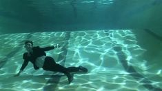 Deep End Dance by Conor Horgan. Mother and son, above and below the surface.