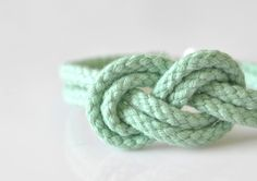 I tie this knot ALL the time, and I love the color! Double 8 Infinity Knot Bracelet Mint by DobleEle on Etsy