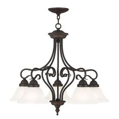 Lighting is one of the most important elements in a design and nothing gets noticed quite like a beautiful chandelier. Livex Lighting Coronado 5 Light Chandelier with Shades Down features decorative scroll work holding five glass shades.  #Chandelier #VanDykes #CeilingLight