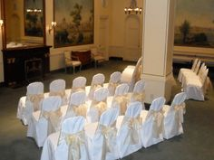 b11d7038c57db3 White chair covers with gold organza bows Rent Chair Covers