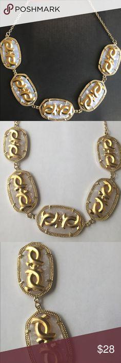 Lia Mia Dia Necklace 🆕📣 Item Lia mia dia Necklace                                                          • Colors: white and gold                                                         • Style x crisscrossing design with gold accent around the oval style shape lia mia dia Jewelry Necklaces