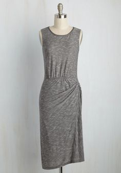 Forgo the apron tonight, instead slipping into this casual-chic dress for a meal made by the city's finest chef! With a static grey hue, a striped neckline, and a twist at the hip, this knit frock keeps you comfortable through each taste, sip, and laugh.