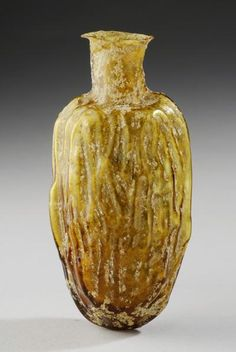 Roman Glass Perfume Flask in the Shape of a Date | 1st Century AD, 2nd Century AD | Price $2,800.00 | Roman | Glass | Vessels | eTiquities by Phoenix Ancient Art
