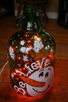 Pin by Linda Brock on Christmas tree Wine Jug Crafts, Crafts With Glass Jars, Glass Bottle Crafts, Wine Craft, Wine Bottle Art, Painted Wine Bottles, Lighted Wine Bottles, Cork Crafts, Holiday Crafts
