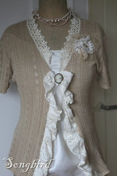 Beautiful sweater from two dated tops. Full tutorial on website. Very clever.