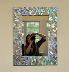 16 DIY Projects Using Old and Scratched CDs - Create an iridescent mirror frame. 16 DIY Projects Using Old and Scratched CDs – Create an iridescent mirror frame. 16 DIY Projects Using Old and Scratched CDs – Create an iridescent mirror frame. Recycled Cds, Recycled Crafts, Diy And Crafts, Old Cd Crafts, Recycled Home Decor, Cd Case Crafts, Kids Crafts, Easy Crafts, Recycled Windows