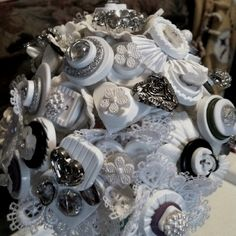 I began making this button bouquet two weeks before my best friends wedding. She called me, completely distraught, after having talked to the woman who was supposed to make her bridal bouquet. The story as I understand it was this: she had ordered a button bouquet from a local crafter whom she knew by reputation to do good work but who she had not personally worked with (april). The woman then contacted her to inform her, two weeks before the wedding (October)... Crunch time, that not only…