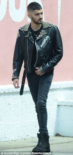 Been taking tips from Gigi? Zayn Malik tries his hand at modelling as he poses in studded leather jacket for street photoshoot | Daily Mail Online