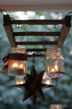 Pottery Barn inspired ladder lantern hanger.  maybe back porch?  could hang plants and lanterns from it?