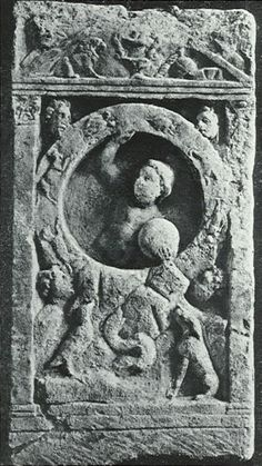 Mithras and the zodiac, Trier - Rheinisches Landesmuseum, Trier. - Augusta Treverorum A representation of Mithras' rock-birth. In his l.h. the youthful, naked god carries a globe and with his upraised r.h. he supports the Zodiac. In the four corners, which are left open by the circle, are the busts of the four Winds: On the rock a raven, serpent and sitting dog, all three of them raising their heads towards Mithras. In the upper corners the dressed busts of Sol and Luna.