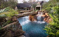 A Backyard Oasis With Pool,Waterfalls,Water Features,Natural Stone,Tropical Plants & Lush Landscaping