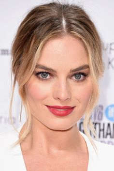 Margot Robbie: Romantic MatchingThis rosy look is a play on intensity — vibrant color on the lips, diffused pigment on the cheeks, but in completely identical shades. The pairing is classic, but far from antiquated. Tip: Keep the skin radiant and the brows full, to help the look feel modern and fresh. #refinery29 http://www.refinery29.com/2016/12/133551/la-celebrity-trend-matching-blush-lip-color-photos#slide-9