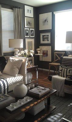 """Forget those """"dead"""" corners in your home... Highlight your corner spaces with custom framed art! In this case, a sure-to-be dark corner is lightened and brightened with an assortment of white and neutral framed artwork - fantastic! 