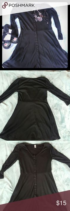 Black A line Tunic Cute black A line Tunic with decorative buttons down the front . Never worn perfect condition.  Size small, im 5'6 and if falls just under my butt. Tops Tunics