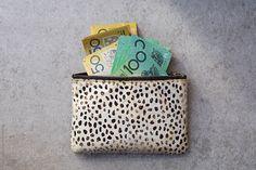 Australian money in 100 and 50 dollar bills by Natalie JEFFCOTT for Stocksy United 211247038756880074
