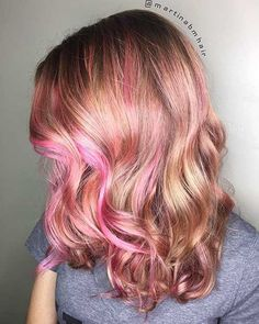 Bright pink and pastel blonde coloring look great on this curly bob with bangs, bright pink roots create a fuller look. Pink hair color for young women 2018