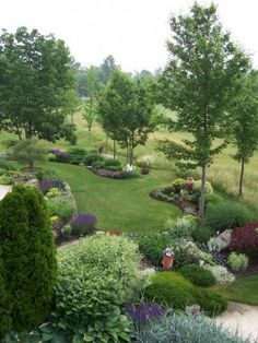 Flowerbeds surround grove of trees. Thoughts?