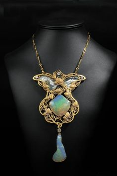 Exceptional Art Nouveau pendant in matte enamelled gold with vegetal decoration adorned with two opals and four old cut diamonds - Paul Robin - gross weight: 63.2 g - h: 16 cm W: 10 cm