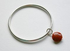 Silver Bangle with Coral Charm £30.00
