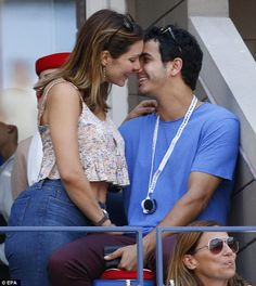 Lovebirds: Scorpion costars Katharine McPhee and Elyse Gabel shared a kiss while attending the US Open tennis in Queens on Monday