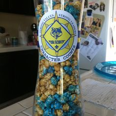 Cubscouts Blue and Gold banquet centerpieces. Large hurricane vase with caramel popcorn and blue raspberry popcorn. Edible and easy for the kids to enjoy.