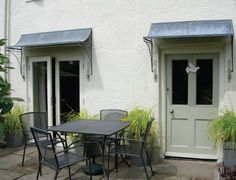 Over Door Porches - Door Canopy Designs - Metal Planters Over Door Canopy, Door Canopy Porch, Porch Doors, Porch Awning, Front Doors, Backyard Canopy, Canopy Outdoor, Canopy Tent, Fabric Canopy