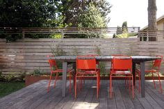 I like the idea of doing vertical fencing for privacy along the south (and maybe north) side of the patio