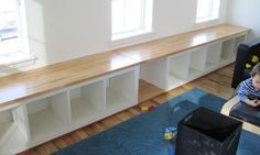 Bench. IKEA.  http://www.kylieminteriors.ca/wp-content/uploads/2013/12/window-bench-with-ikea-expedit-bookshelf-idea-with-wood-top.jpg