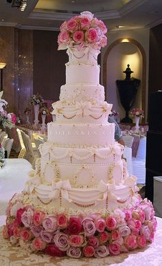For my wedding, I would want a big cake with flowers & decorations like this to match my dress.