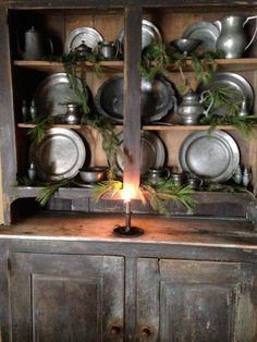 Early black pewter cupboard.