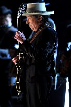 Musician Bob Dylan performs onstage during the AFI Lifetime Achievement Award A Tribute to Michael Douglas held at Sony Pictures Studios on June 11...
