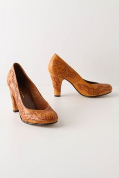 Hand tooled leather heels!  Holy expensive, but these would be so cool to have and pass down through your family.