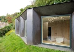 This small studio with a green roof and patinated copper walls creates a secluded spot for deer-watching.